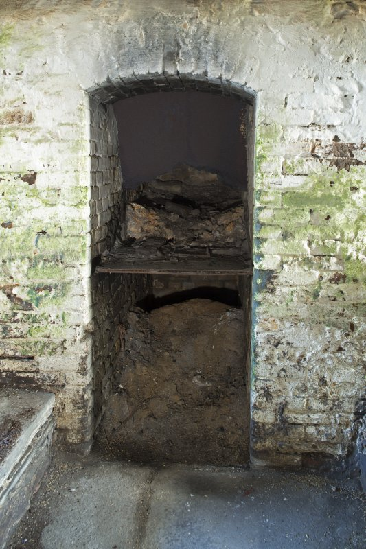 Interior. Detail of kiln furnace opening at ground floor level.