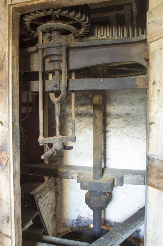 Interior. View looking into machinery cupboard to main drive shaft and mill workings.