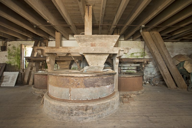 Interior. View of the millstones and milling machinery at first floor of the mill.