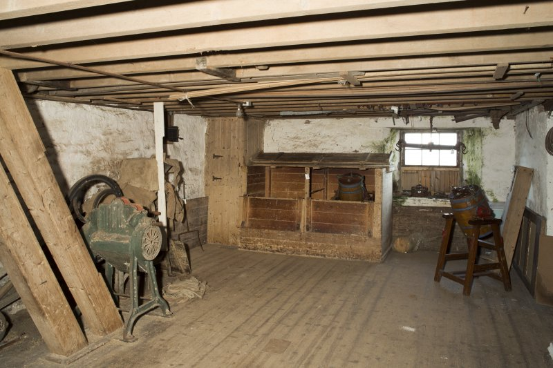 Interior. View of storage hoppers and machinery within the first floor level of the mill.