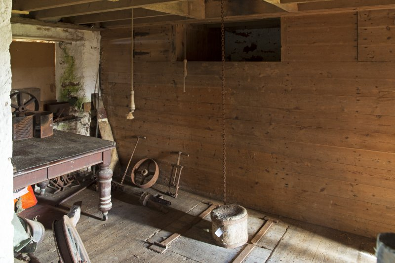 Interior. View of the top of the grain hoppers and sack hoist hatch within the first floor of the mill.