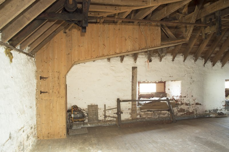 Interior. View of former grain hoist on north wall of the second floor level of mill.
