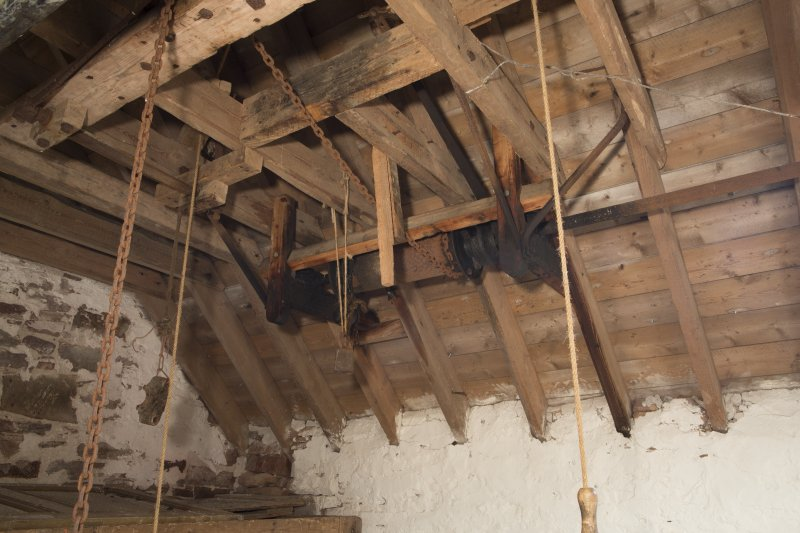 Interior, View of sack hoisting mechanism to the south end of the mill's second floor.