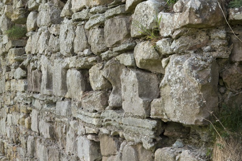Close up of the joist holes in the secondary stonework in the Teviotside curtain wall of Roxburgh castle, from the NE