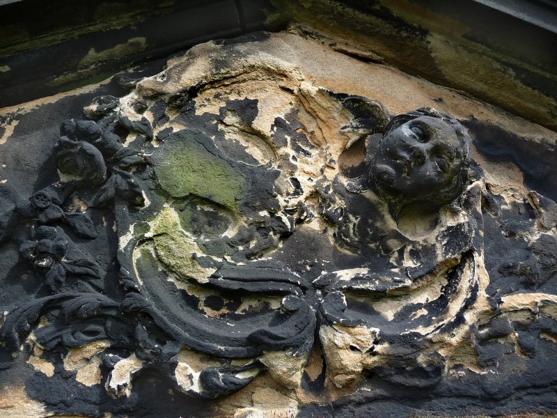 Detail of Relief showing angels, weathered, Canongate Kirk Cemetery, Edinburgh