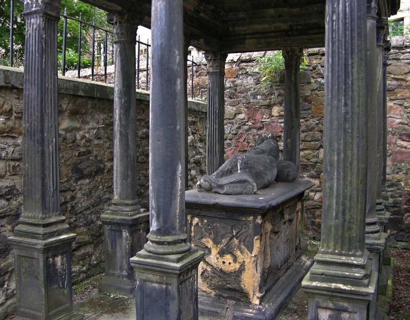 Detail of family vault, damaged, Greyfriar's Burial Ground, Edinburgh.