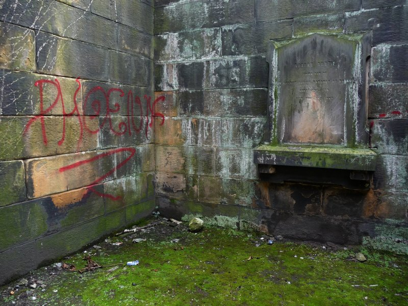 Detail of Suttie family vault, with graffiti, Canongate Kirk Cemetery, Edinburgh.