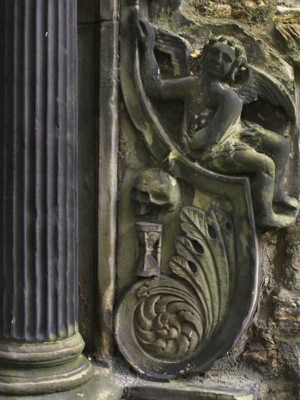 Detail of relief showing angel and skull at Greyfriar's Churchyard, Edinburgh.