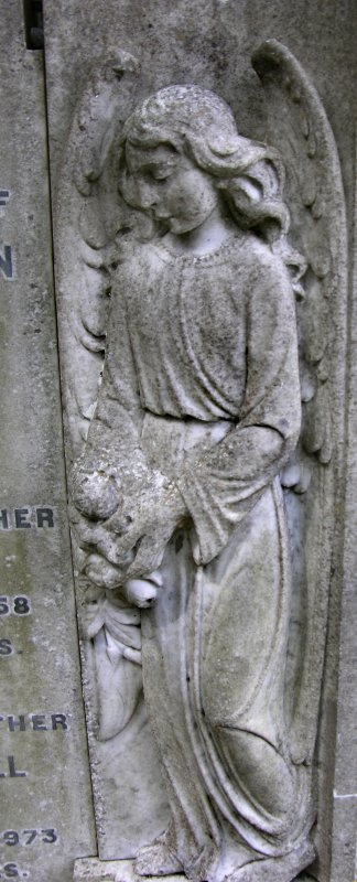 Detail of relief showing angel at side of headstone, Newington Cemetery, Edinburgh.