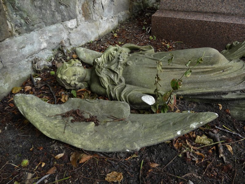 Image showing a badly damaged statue of an angel, fallen. Morningside Cemetery, Edinburgh.