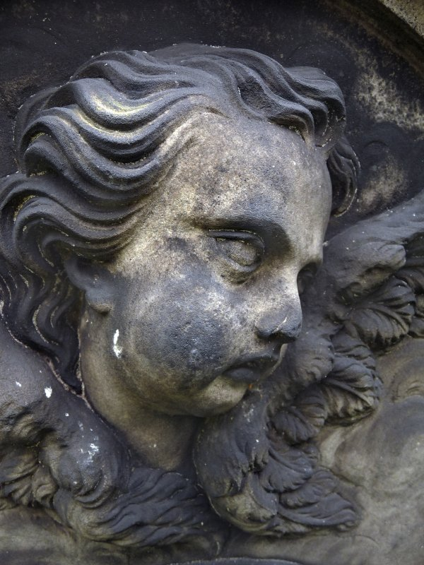 Detail of a relief showing the head of an angel, Old Calton Burial Ground, Edinburgh.