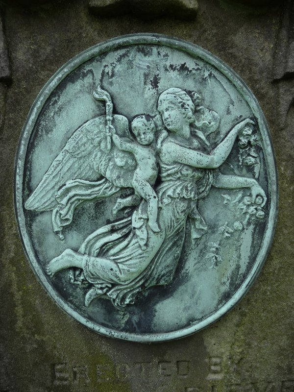 Detail of bronze relief showing an angel and cherub, Morningside Cemetery, Edinburgh.