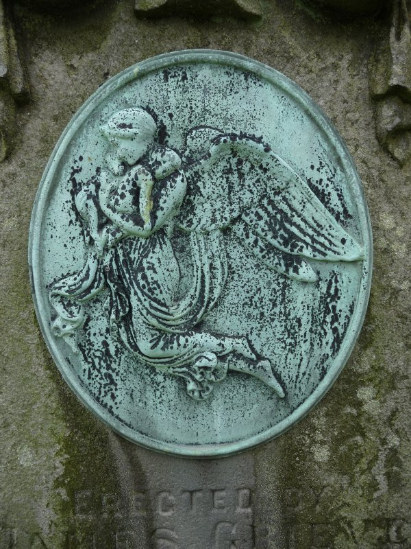 Detail of bronze relief of an angel, corroded, Morningside Cemetery, Edinburgh.