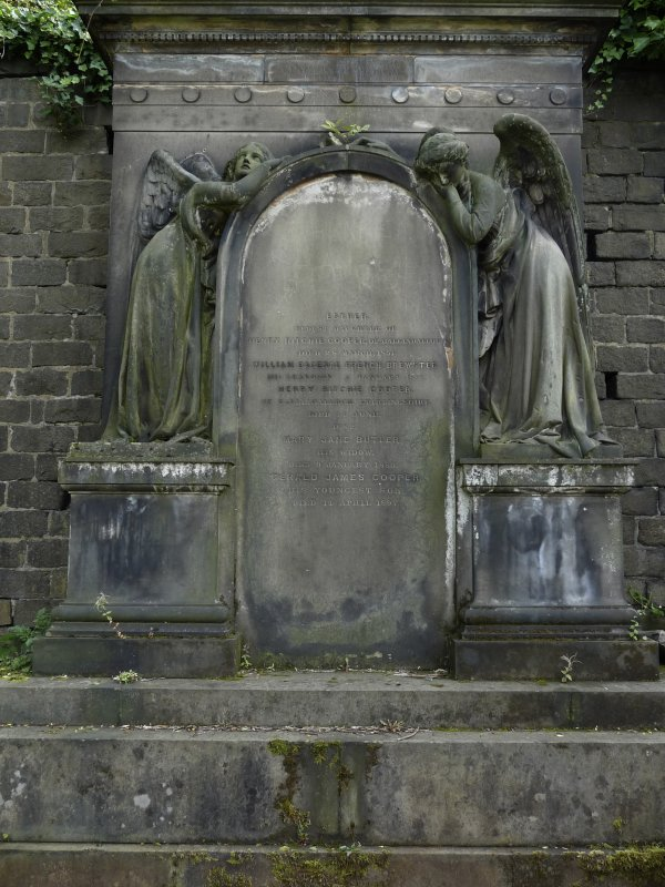 Detail of relief showing two angels surrounding a headstone, in memory of members of the Cooper family. Glasgow Necropolis.