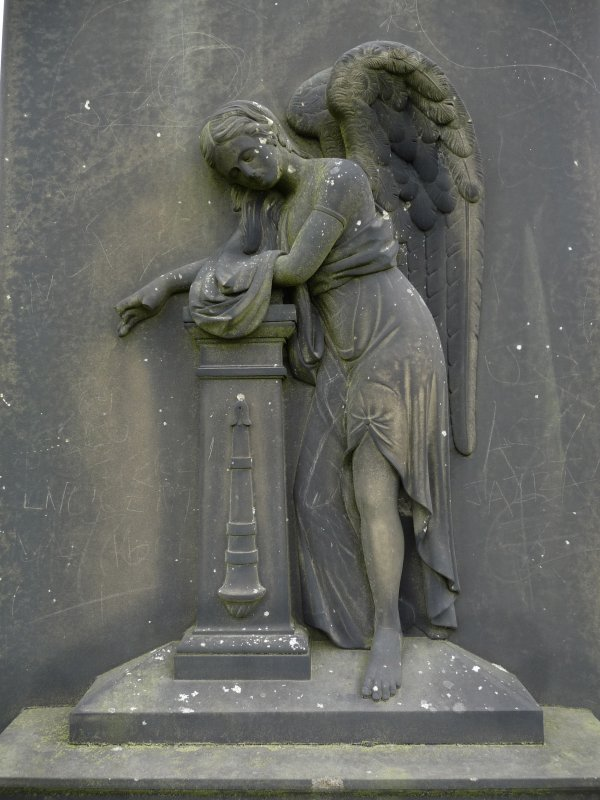 Detail of relief showing an angel leaning on a pillar, covered in graffiti, Galsgow Nercropolis.