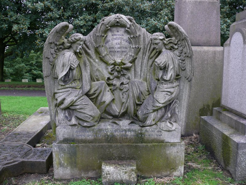 Detail of relief showing to angels either side of a headstone, in memory of David Edmund Dutram, c.1893.