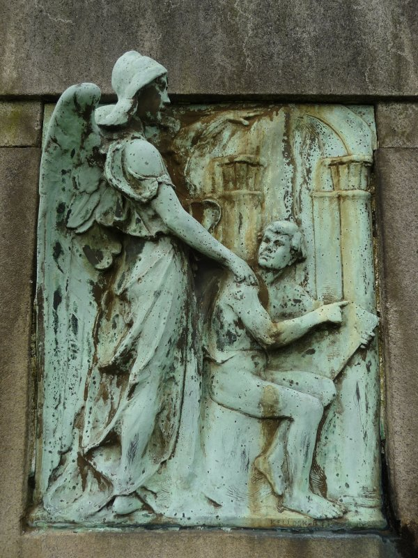 Detail of bronze relief showing an angel standing behind a man, corroded. The Glasgow Necropolis.