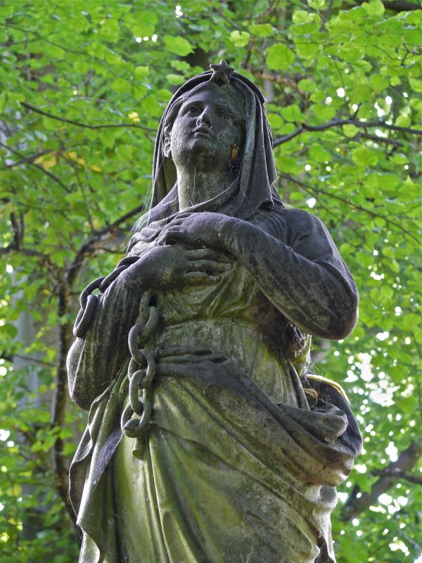 Detail of monumental statue showing woman holding chain. Gravestone of Peter Johnston, Coachbuilder, Newington Cemetery, Edinburgh.