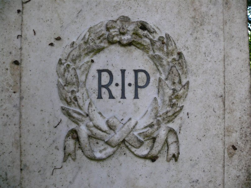 Detail of gravestone in memory of Mary Jane Innes and Alexander Innes, showing wreath, with 'R.I.P' inscribed in centre, Newington Cemetery, Edinburgh.