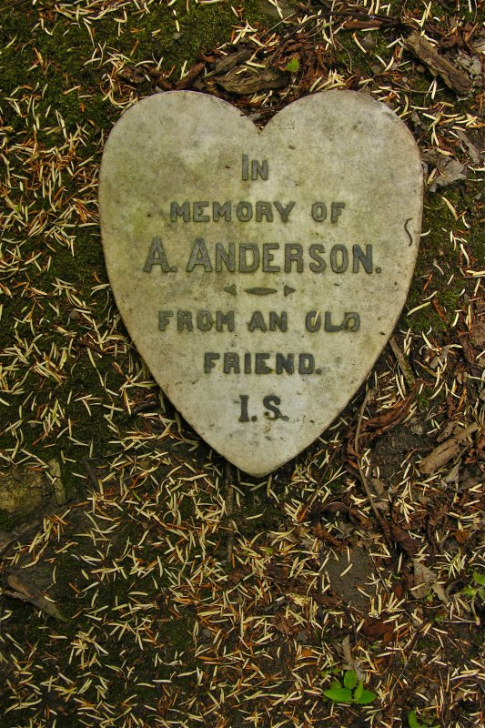 Heart-shaped gravestone inscribed 'IN MEMORY OF A. ANDERSON FROM AN OLD FRIEND. I.S.', Newington Cemetery, Edinburgh.