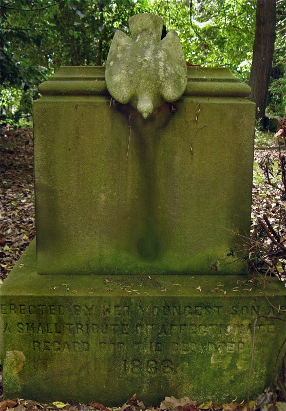 View of gravestone topped with dove statue. Incribed: 'Erected by... youngest son as a small tribute of affectionate regard for the departed, 1888', Newington Cemetery, Edinburgh.