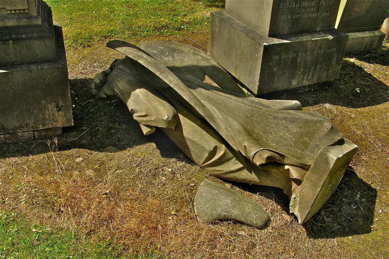 Detail of fallen stone angel from gravestone in memory of Ormond Haldane Garland M.D, Newington Cemetery, Edinburgh.