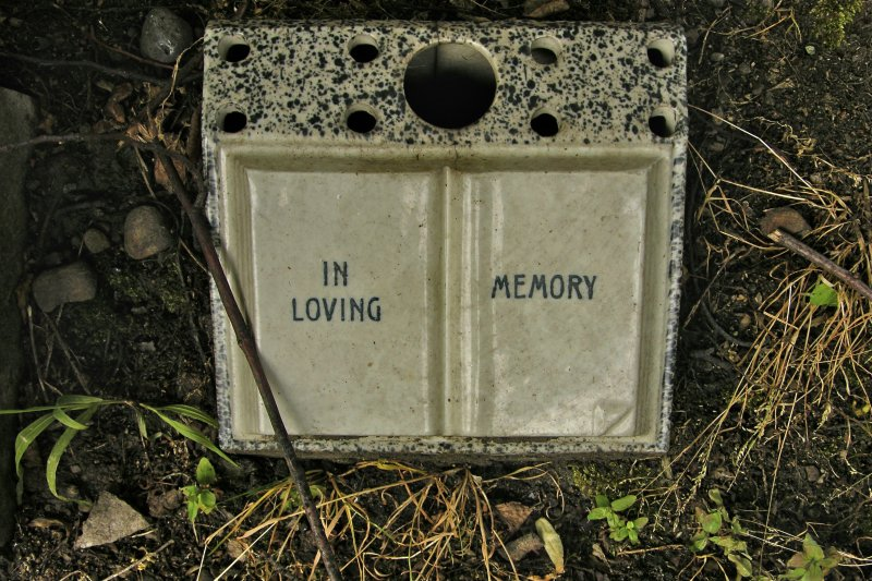 Detail of unidentified gravestone fragment inscribed 'In loving memory', Newington Cemetery, Edinburgh.