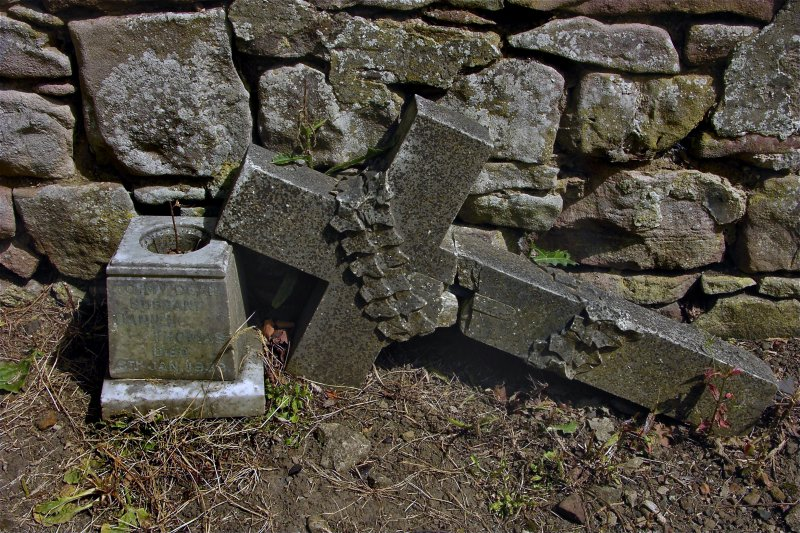View of fragments from gravestone in memory of Daniel Thomas, d. 1939. Located against the Dalkeith Road wall, Newington Cemetery, Edinburgh.
