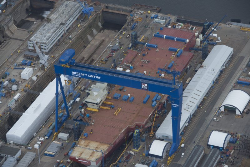 Oblique aerial view of the Goliath Crane and construction of aircraft carrier, looking to the SSE.
