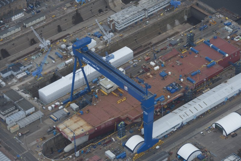 Oblique aerial view of the Goliath Crane and construction of aircraft carrier, looking to the SE.