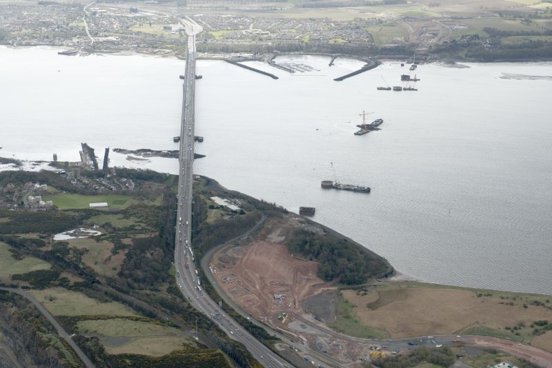 Oblique aerial view during construction of the New Forth Bridge Crossing, looking to the S.