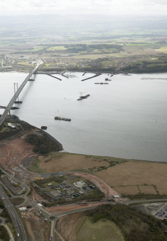 Oblique aerial view  during construction of the New Forth Bridge Crossing, looking to the SE.
