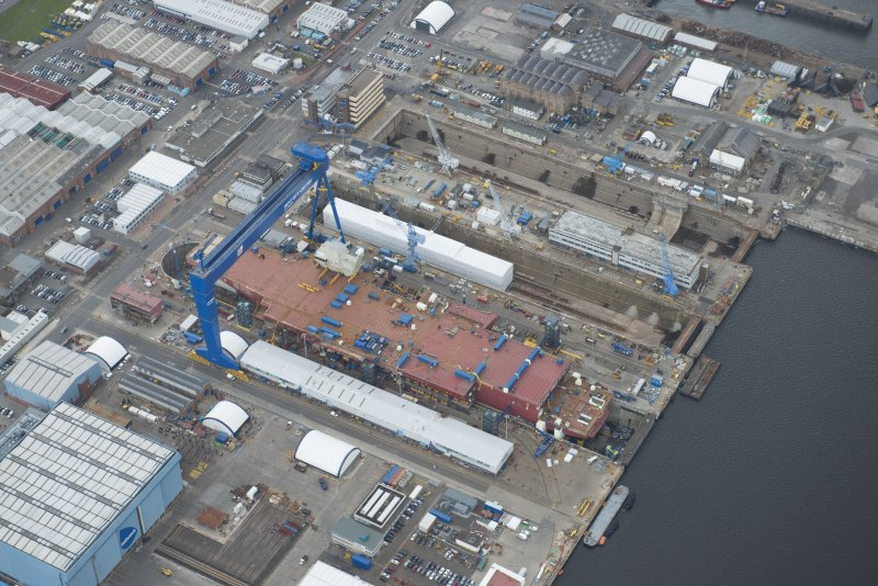 Oblique aerial view of the Goliath Crane and construction of aircraft carrier, looking to the E.