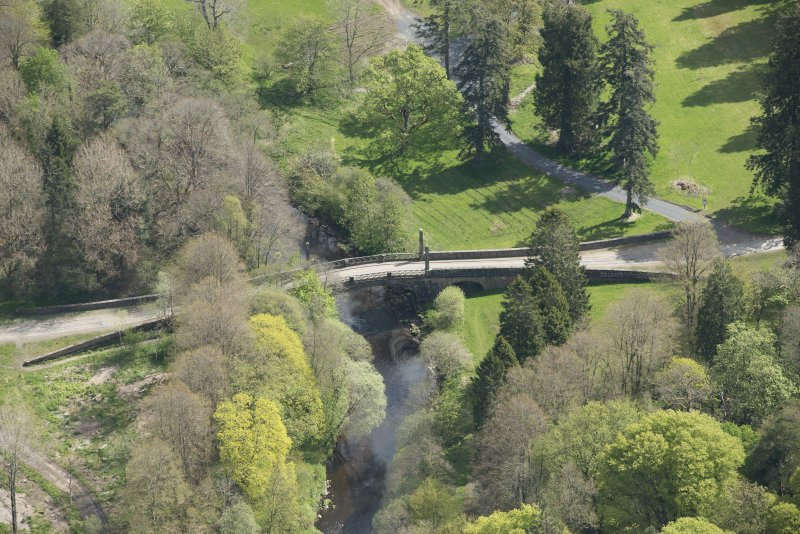 Oblique aerial view of Dumfries House Avenue Bridge, looking to the ENE.