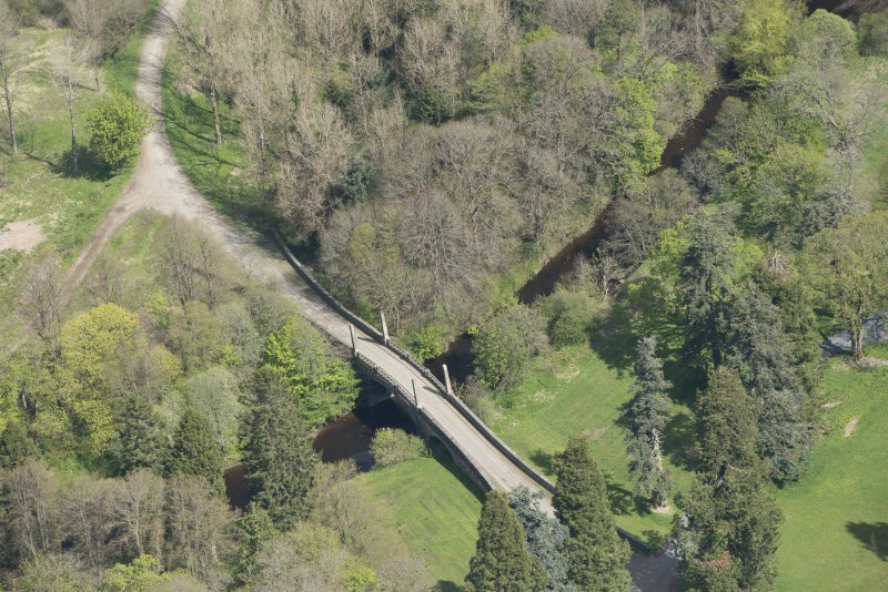 Oblique aerial view of Dumfries House Avenue Bridge, looking to the NNE.
