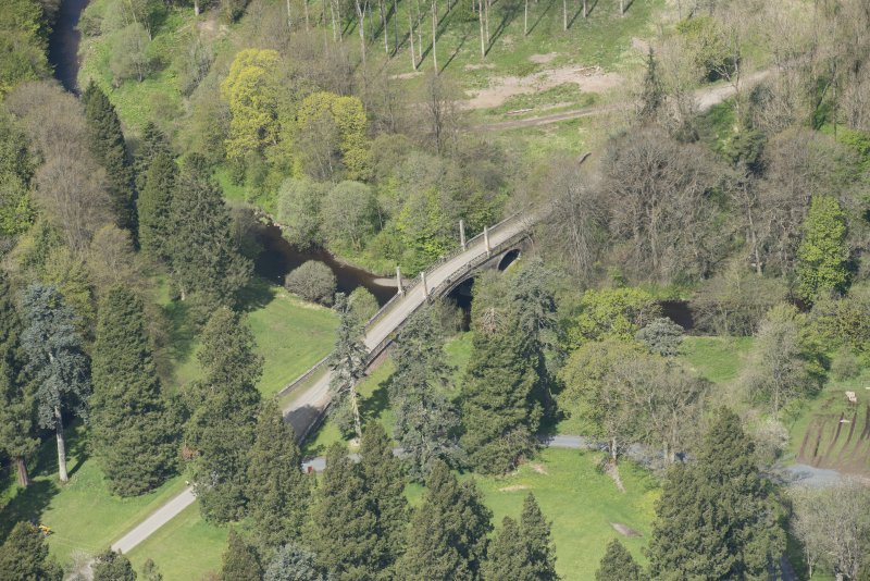 Oblique aerial view of Dumfries House Avenue Bridge, looking to the WNW.