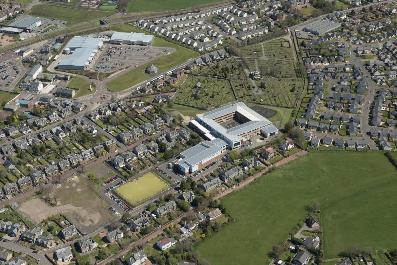 Oblique aerial view of Lanark Grammar School and St Kentigern's Church, looking to the NE.