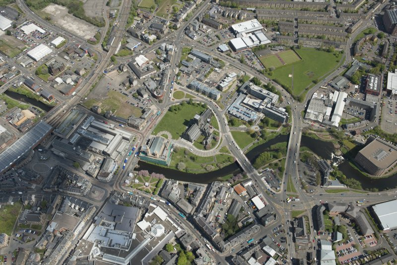General oblique aerial view of the centre of Paisley centred on Paisley Abbey, looking to the NE.