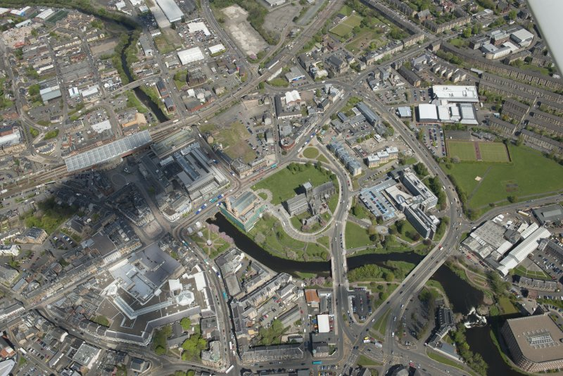 General oblique aerial view of the centre of Paisley centred on Paisley Abbey, looking to the NNE.