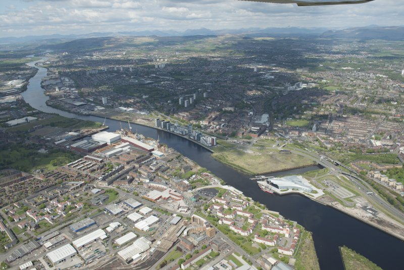 General oblique aerial view of the River Clyde centred on Meadowside Quay, looking to the NW.