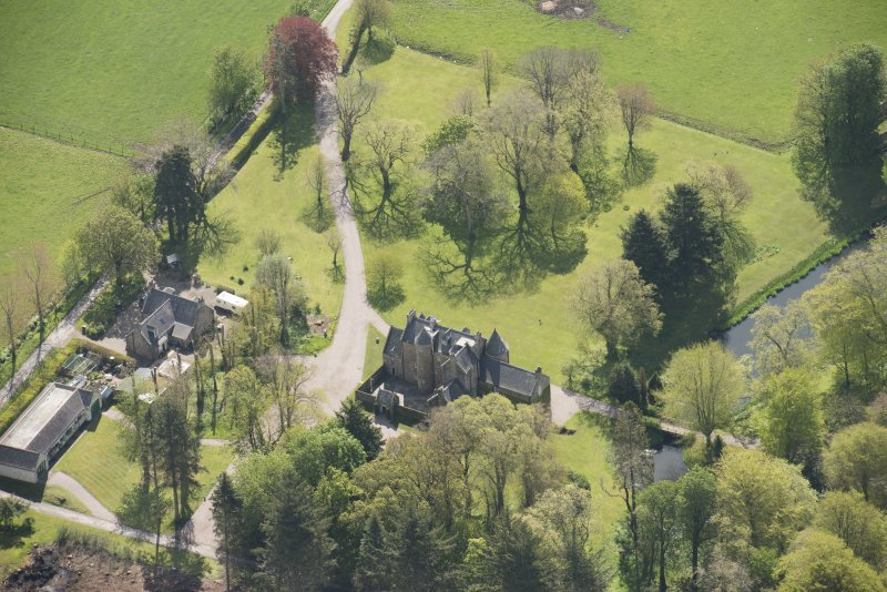 Oblique aerial view of Schivas House, looking to the SE.