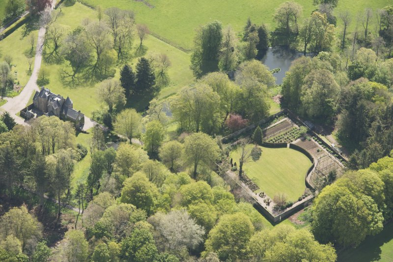 Oblique aerial view of Schivas House, looking to the ESE.