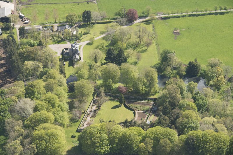 Oblique aerial view of Schivas House, looking to the E.
