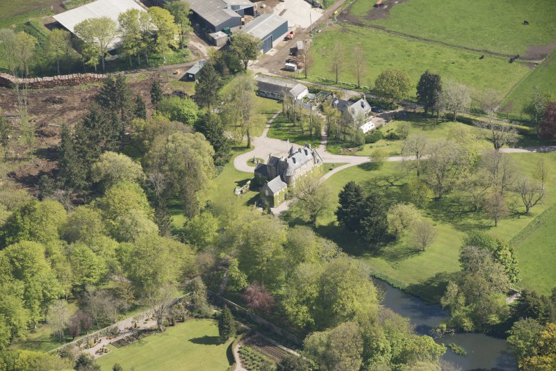 Oblique aerial view of Schivas House, looking to the NNE.