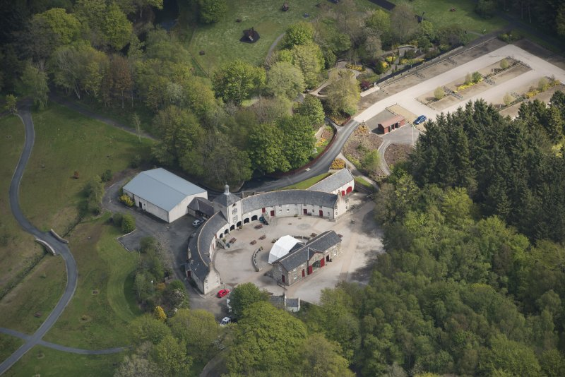 Oblique aerial view of Aberdeenshire Farming Museum, looking to the NNE.