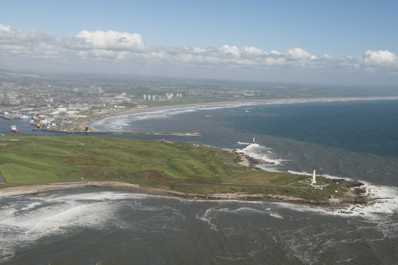 General oblique aerial view of Aberdeen Bay centred on Girdleness Lighthouse and Balnagask Golf Course, looking to the NW.