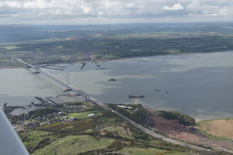 General oblique aerial view of the River Forth centred on the construction of the new  Forth Bridge crossing, looking to the SSW.