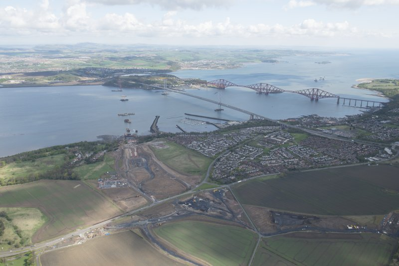 General oblique aerial view of the River Forth centred on the construction of the new  Forth Bridge crossing, looking to the ENE.