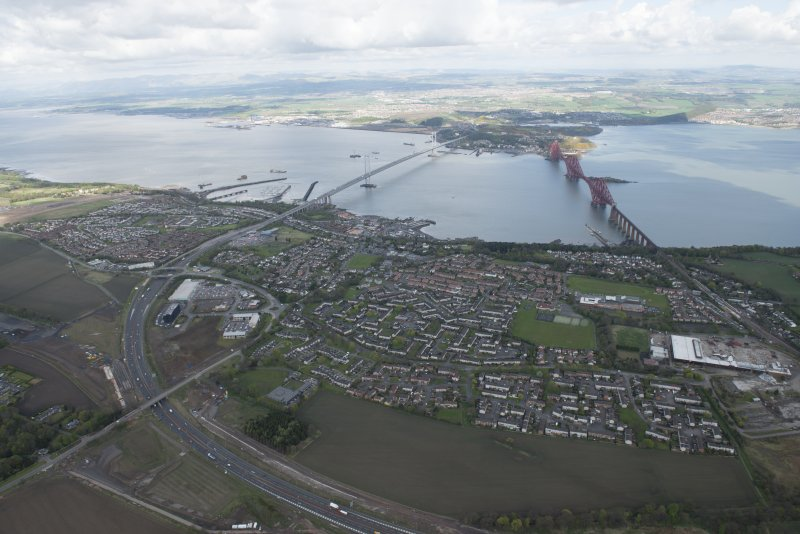 General oblique aerial view of the River Forth centred on the construction of the new  Forth Bridge crossing, looking to the N.