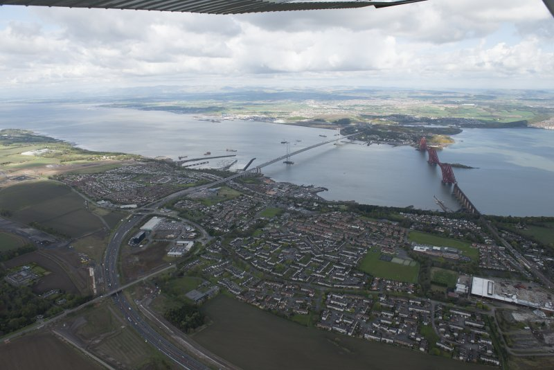 General oblique aerial view of the River Forth centred on the construction of the new  Forth Bridge crossing, looking to the WNW.